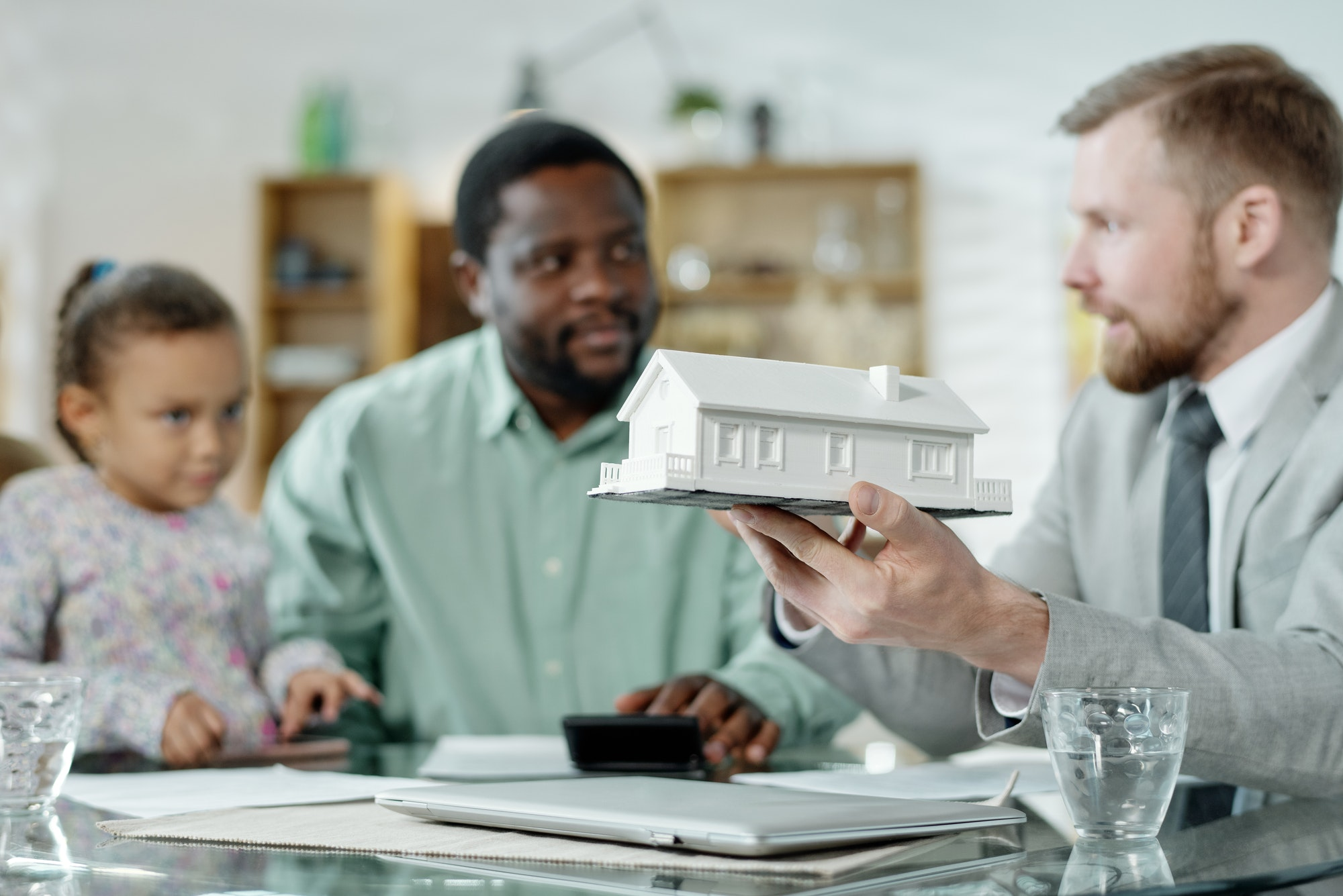 Financial accountant with mockup house giving consultation